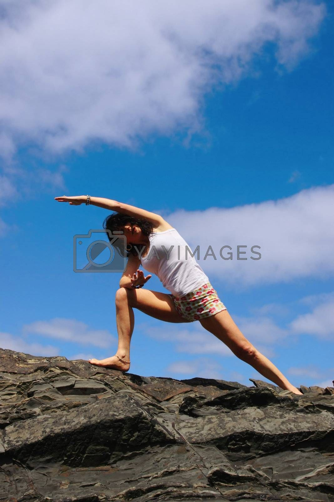 a beautiful woman doing yoga to show a healthy way to live a happy and relaxed lifestyle in a world full of stress