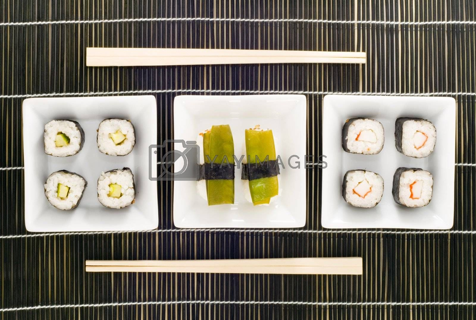 three plates with different kinds of sushi