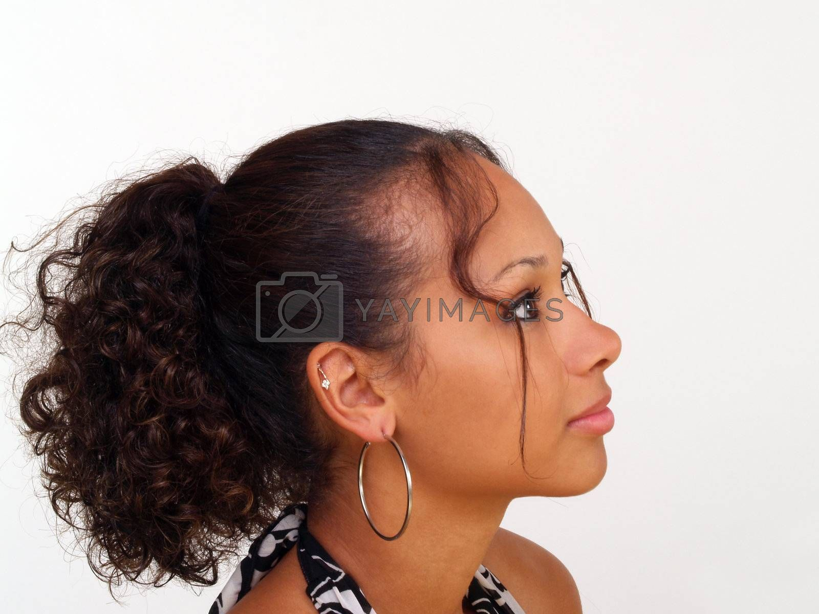 Pretty young black girl in profile portrait