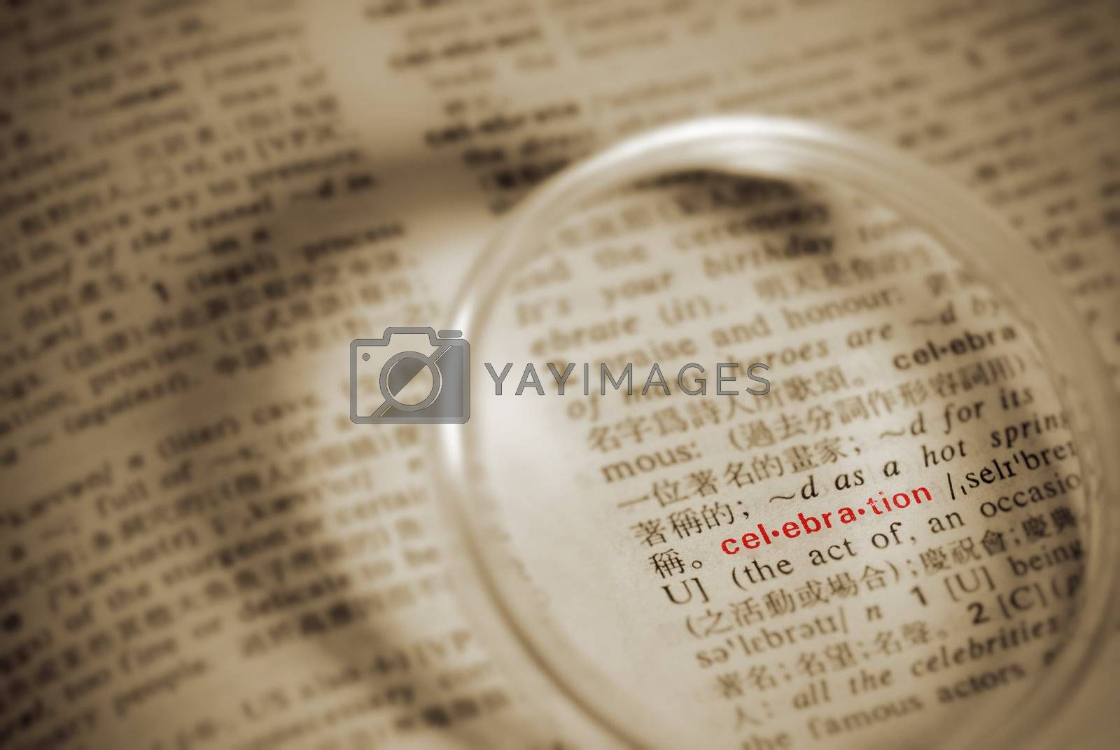 Celebration word on paper with magnifier in yellow color.