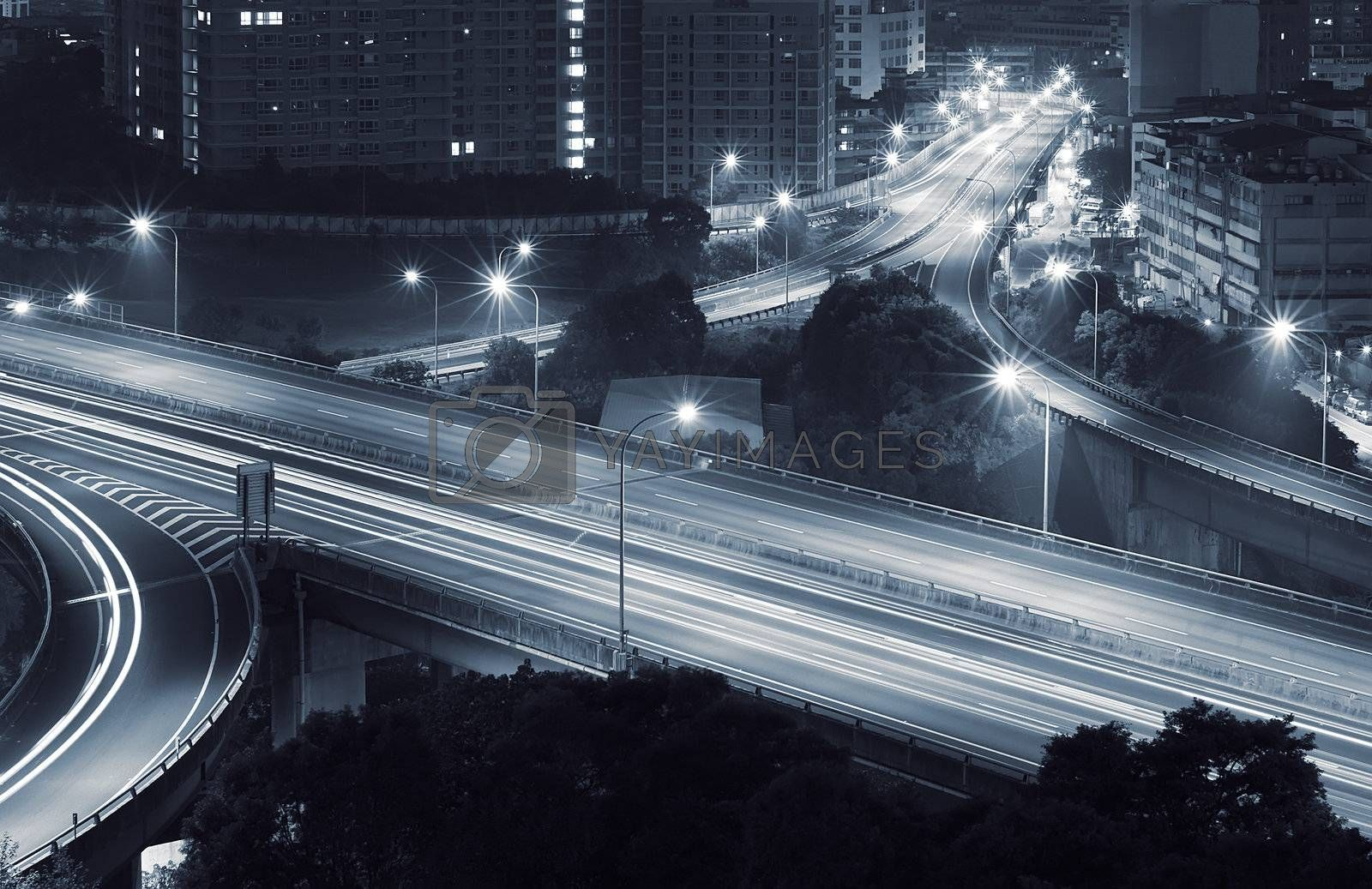 Interchange in city of Taipei in the night with yellow cars lights.