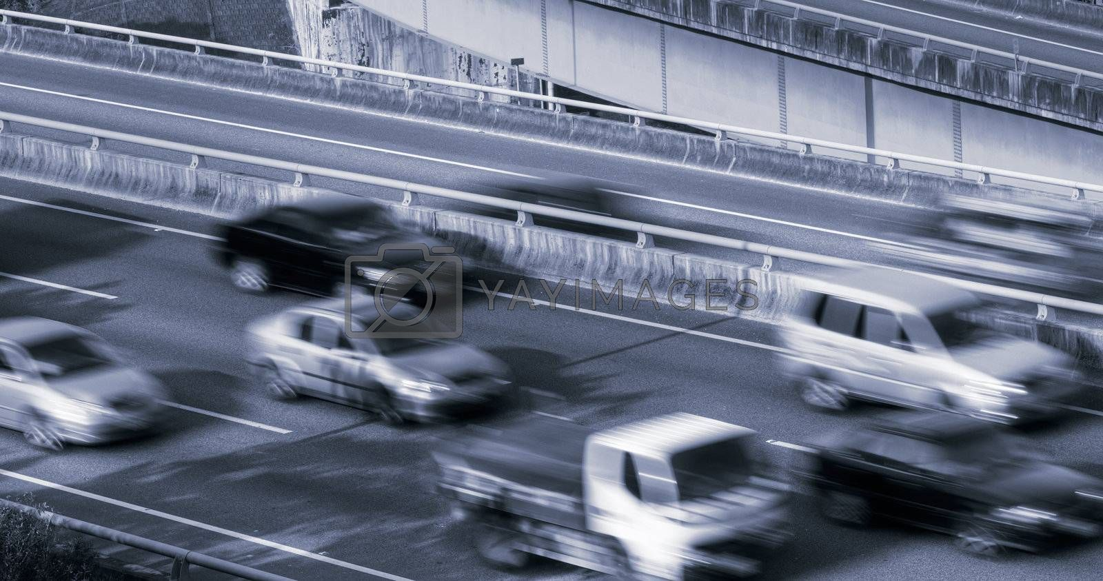 Cars on highway with fast driving and motion in modern city.