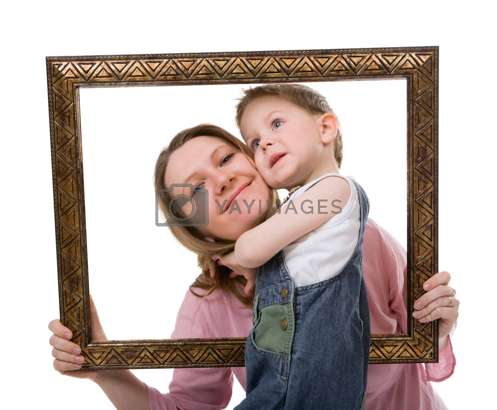 Casual portrait of mother and son having fun together playing with frame. Isolated on white