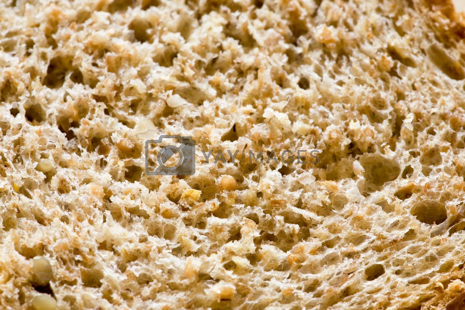 A background texture of freshly sliced brown bread