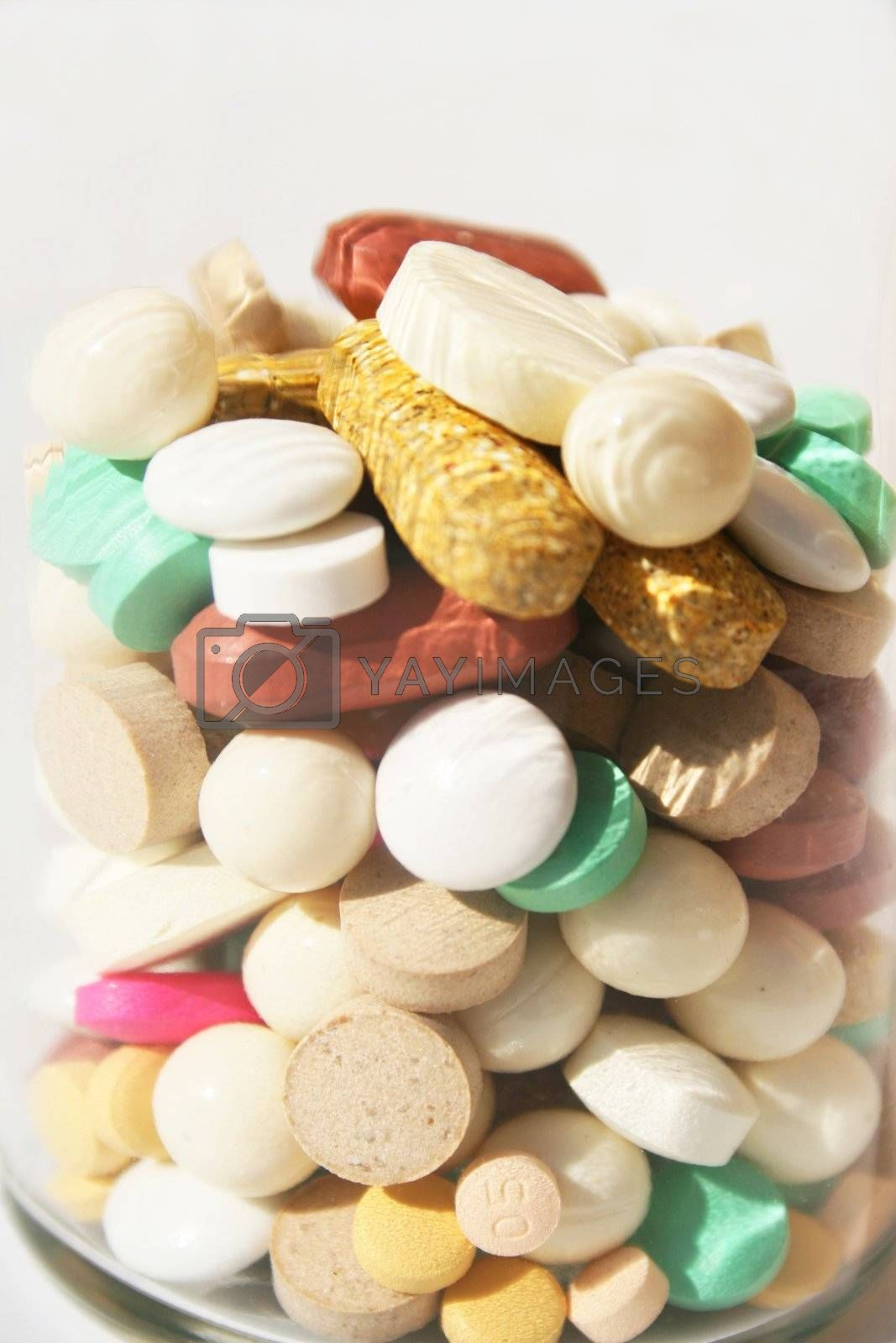 Bottle of various pills close-up