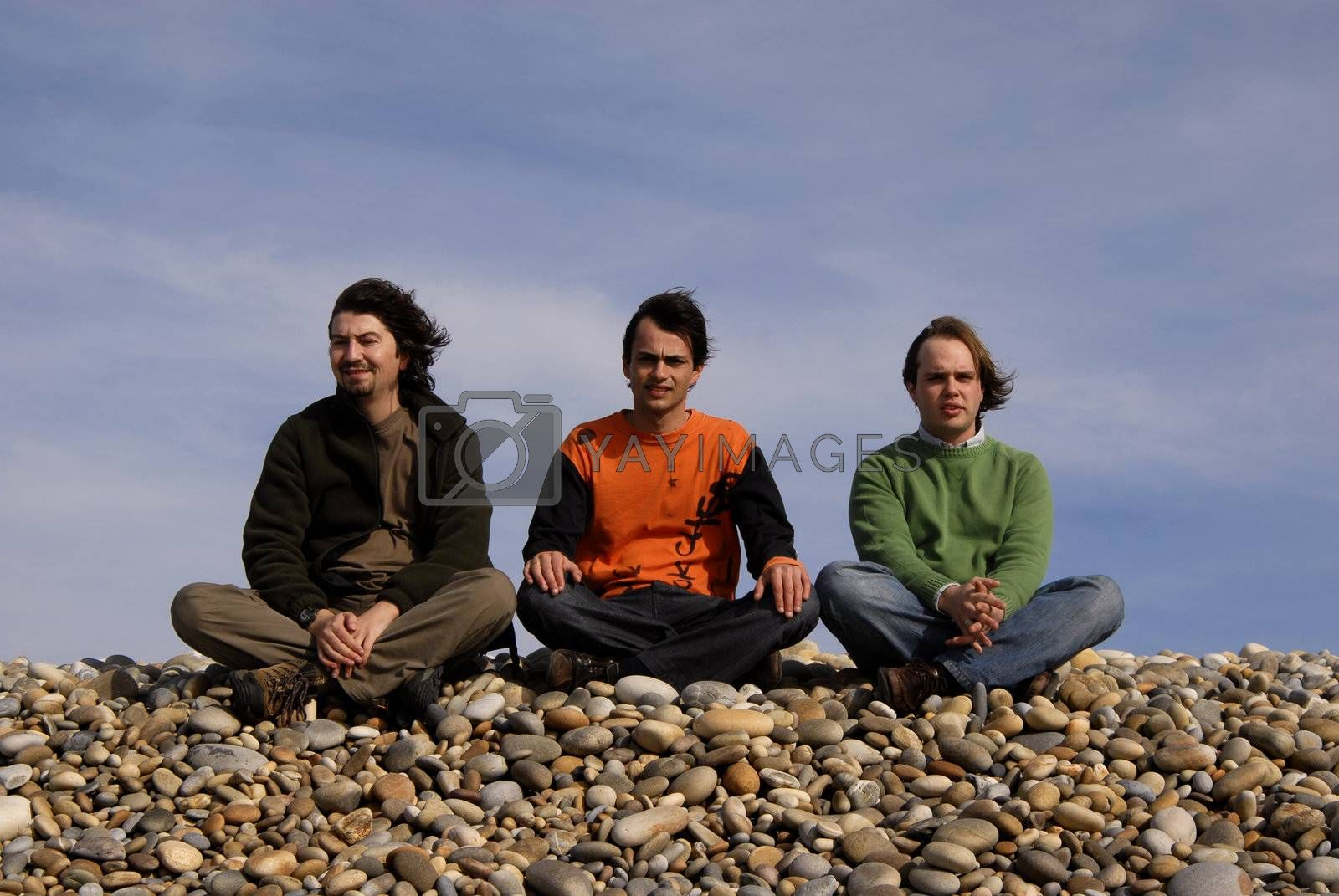 three casual young men at the beach
