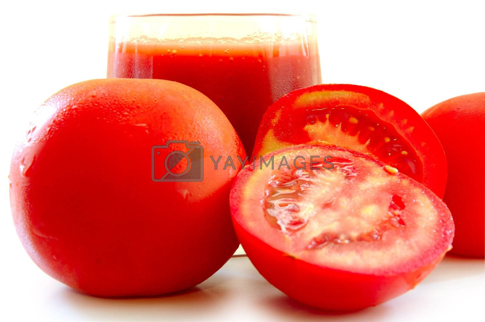 Fresh tomato juice in glass and tomatoes. by alexpurs