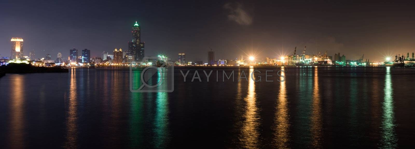 Panorama harbor scenic of city in night with light reflection on ocean in Kaohsiung, Taiwan.