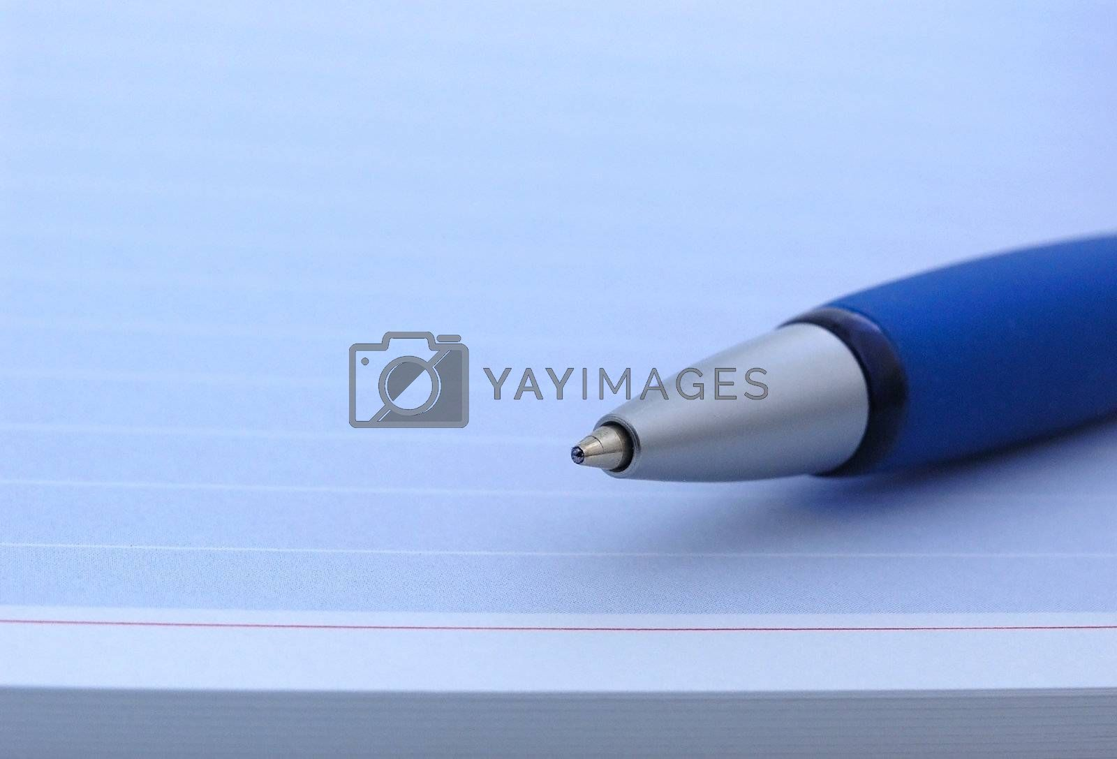 blue pen on a blue notebook