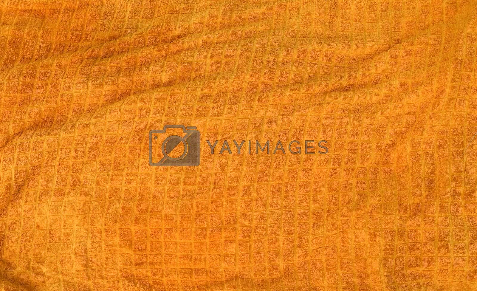 A bright orange cloth towl background texture