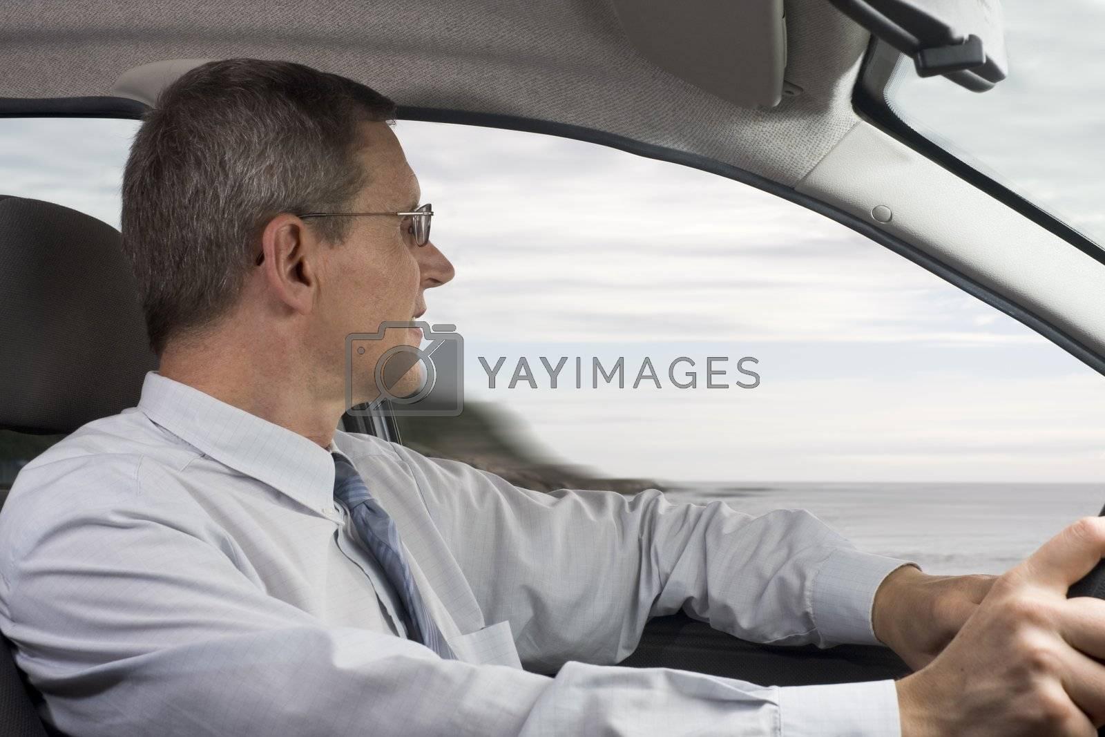 Businessman driving a car by ArtmannWitte