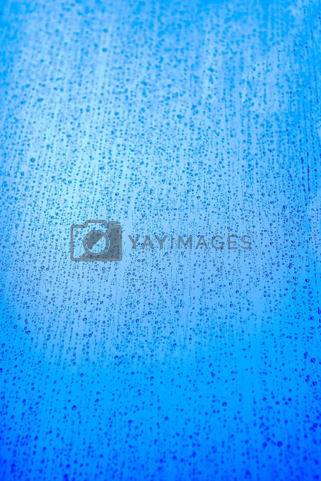 Blue rain background texture image with drops running