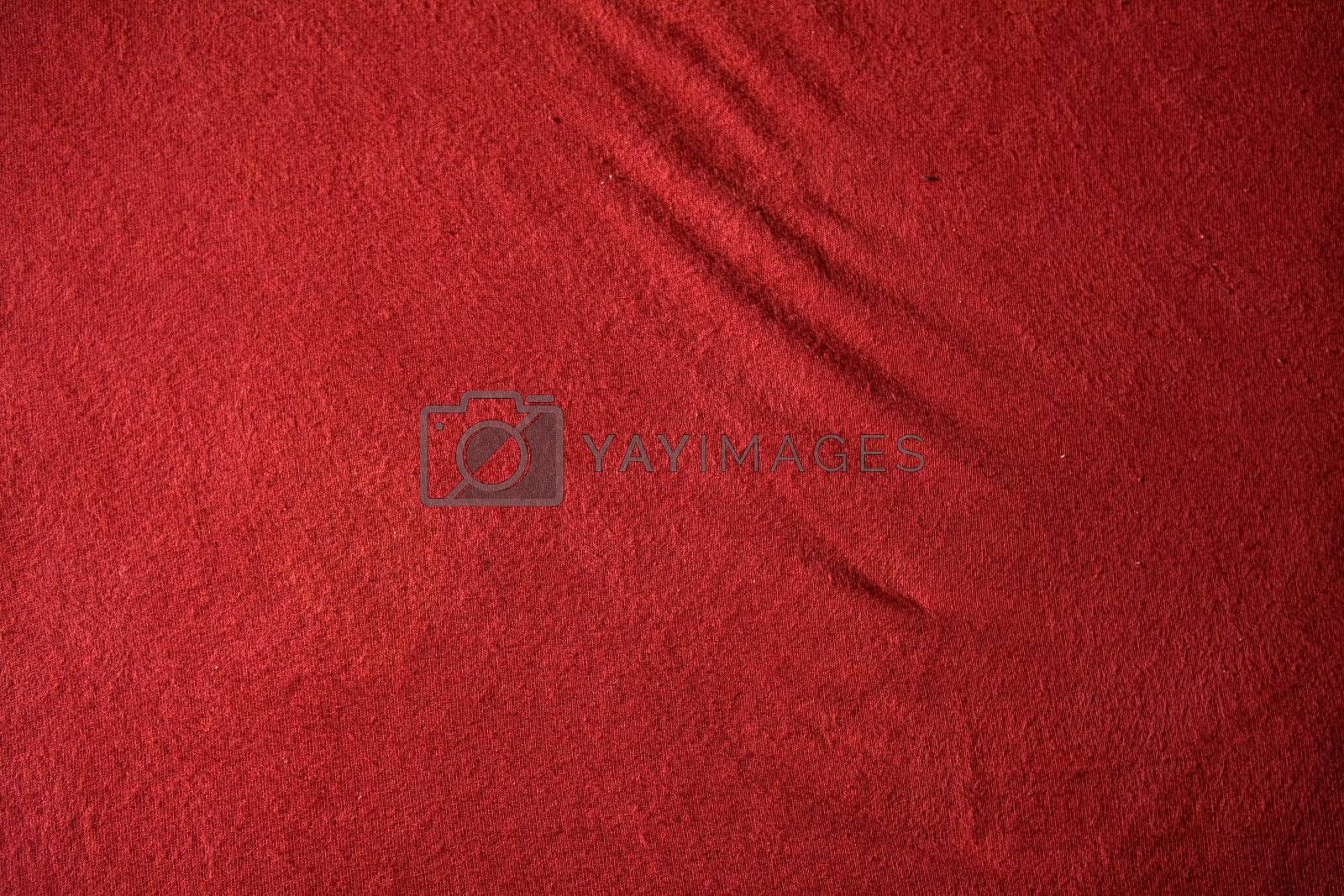 A red cloth texture with strong contrast and lines