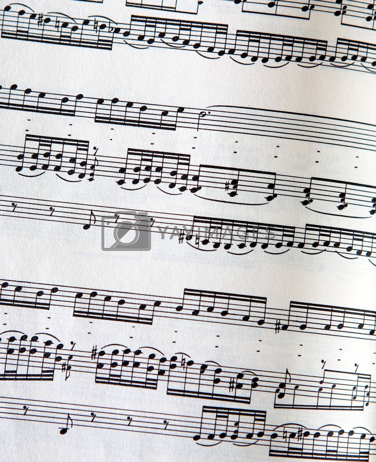 A page of music with detailed paper texture