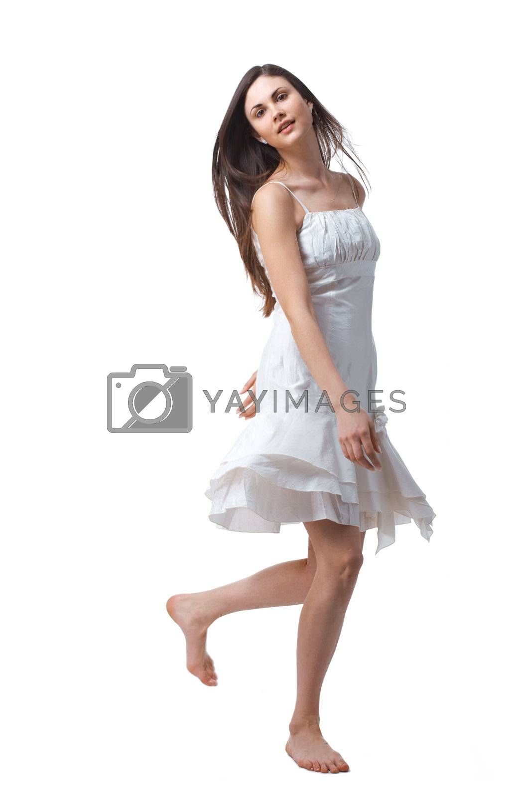 Young beautiful woman jumping on white background