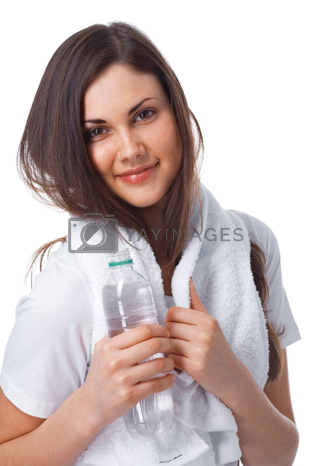 Portrait of a young woman with towel and bottle of water over white