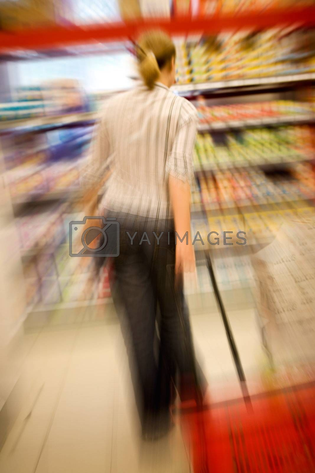 A woman shopping with zooming blur