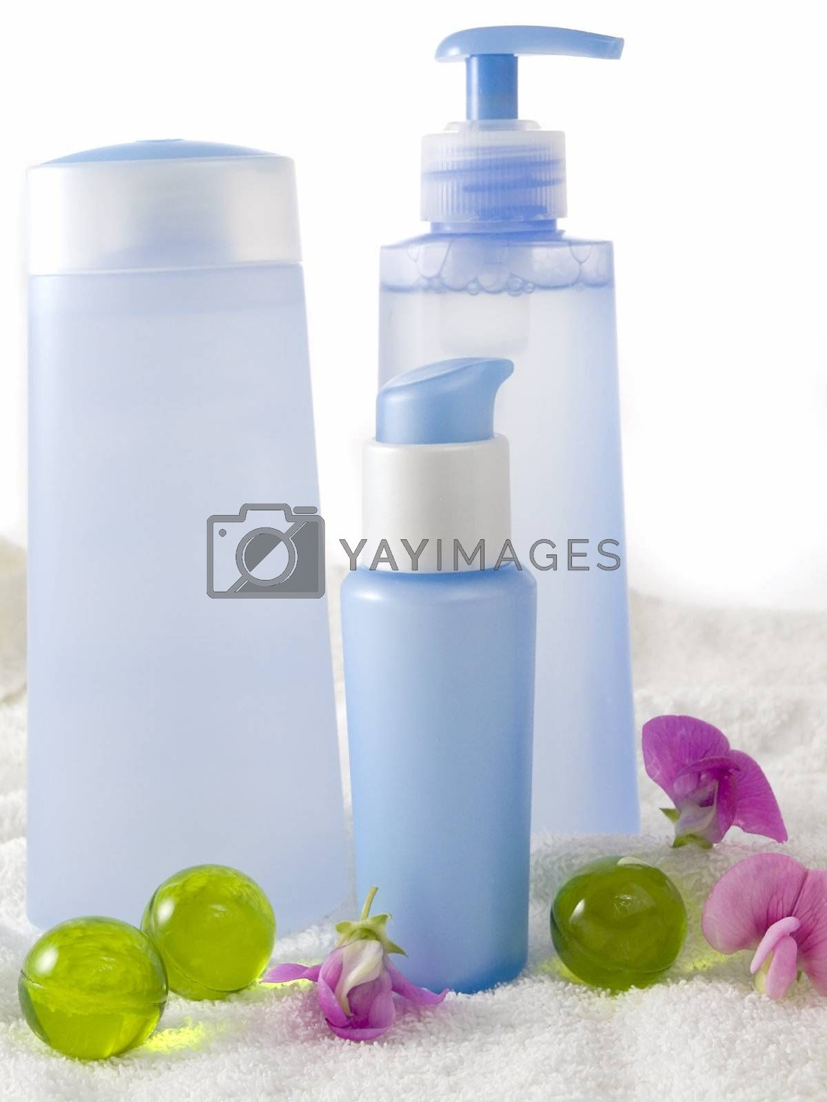 blue cosmetic bottles without labels isolated on white background