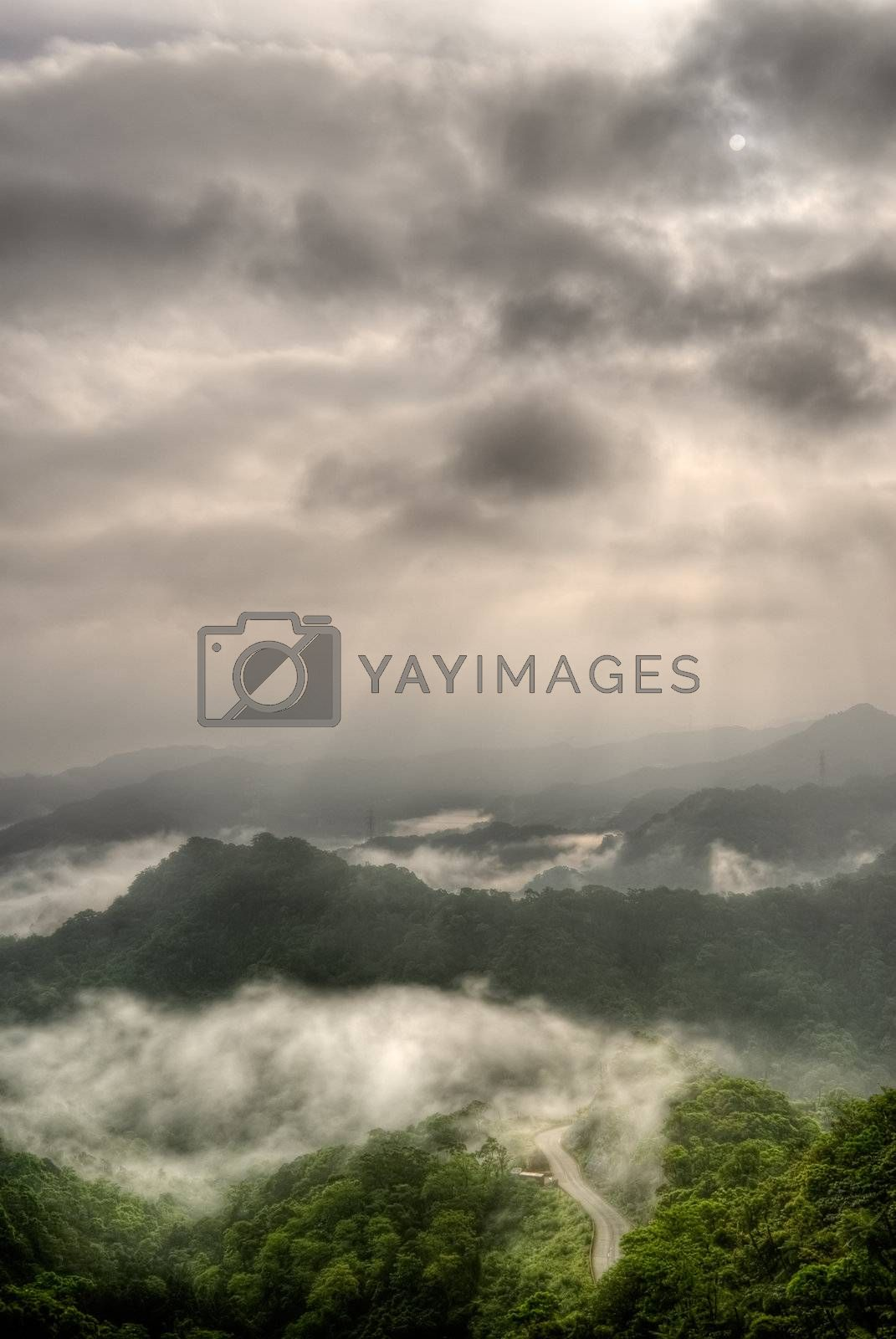 Landscape of mountain with dramatic sky and sunlight in day.