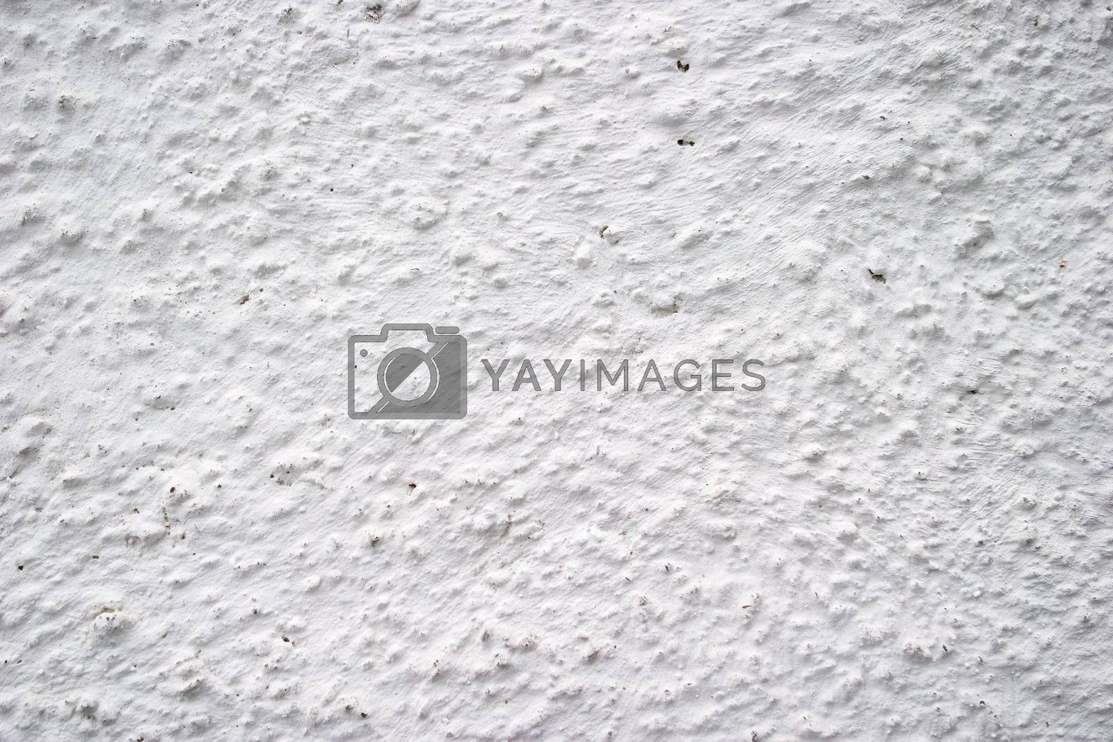 White plaster on an outside wall texture surface.