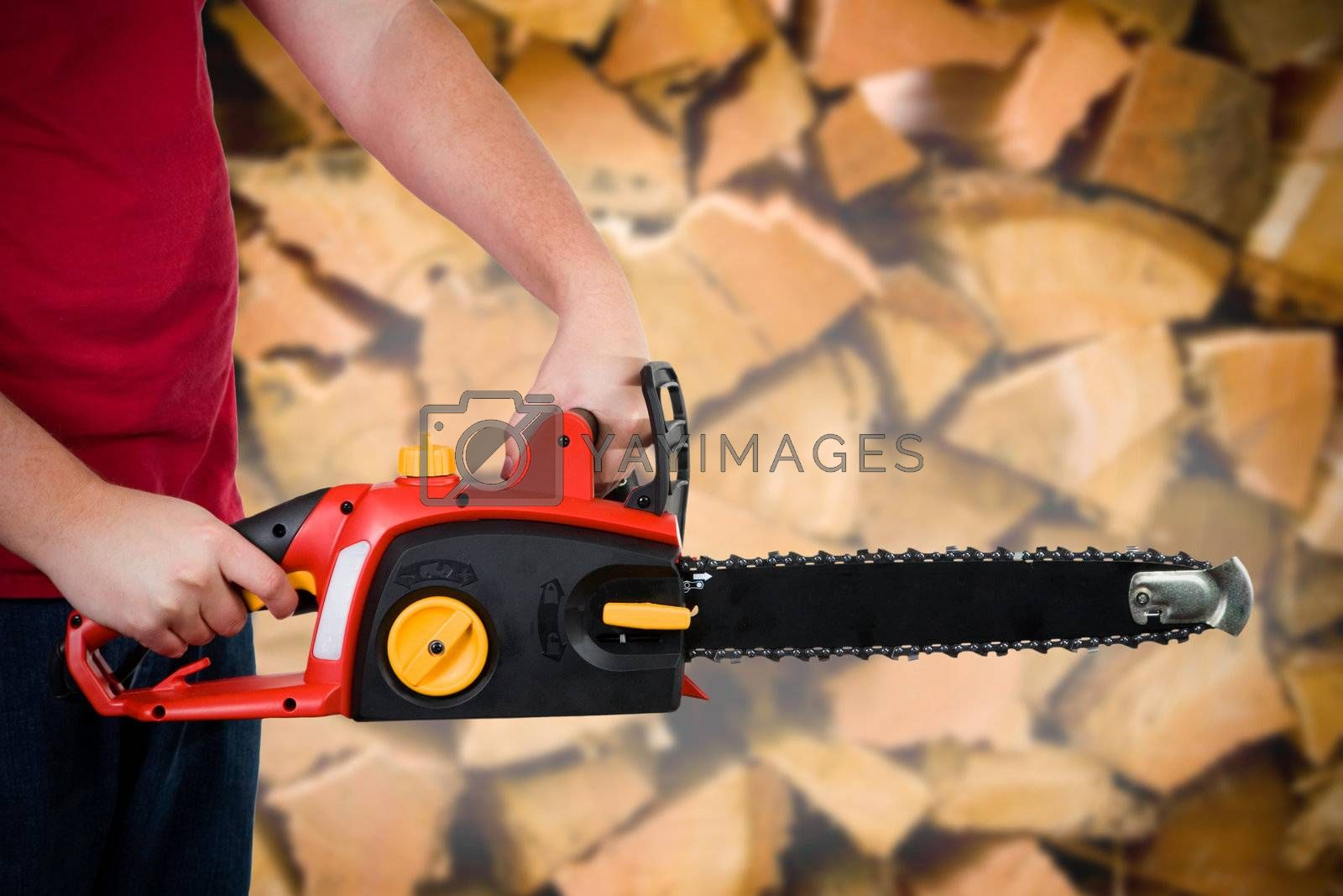 A closeup of a man holding a chainsaw.