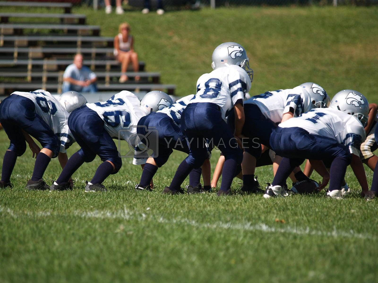 a young american football team ready at the line of scrimmage