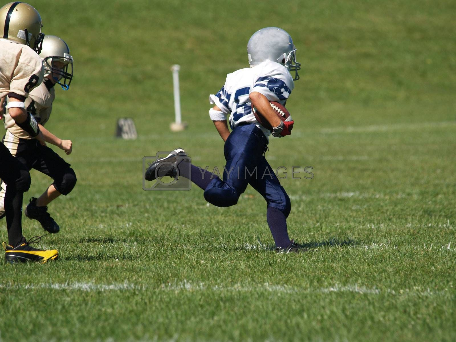 young american football player running for a touchdown