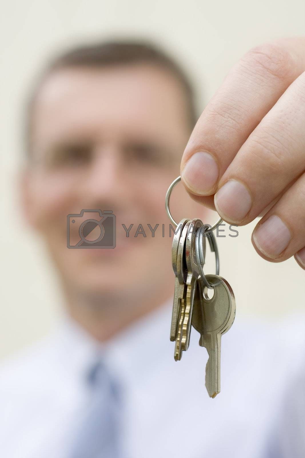 Smiling businessman handing over keys