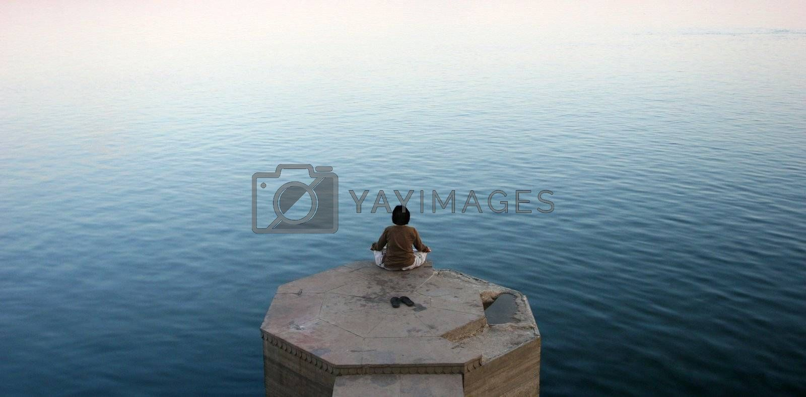 Meditation on a Ganges river bank, Varanasi