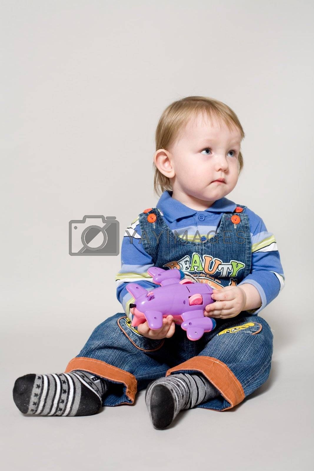 people series: little boy with toy offended