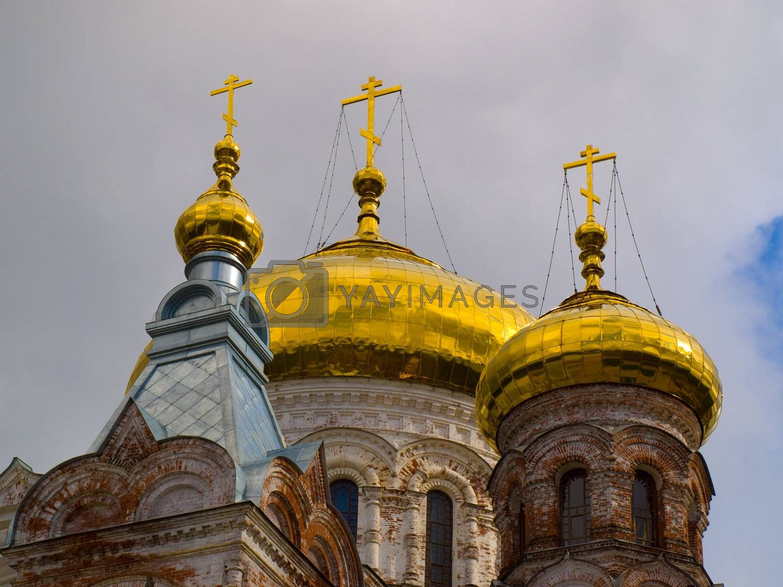 Golden domes with a crosses of christian temple