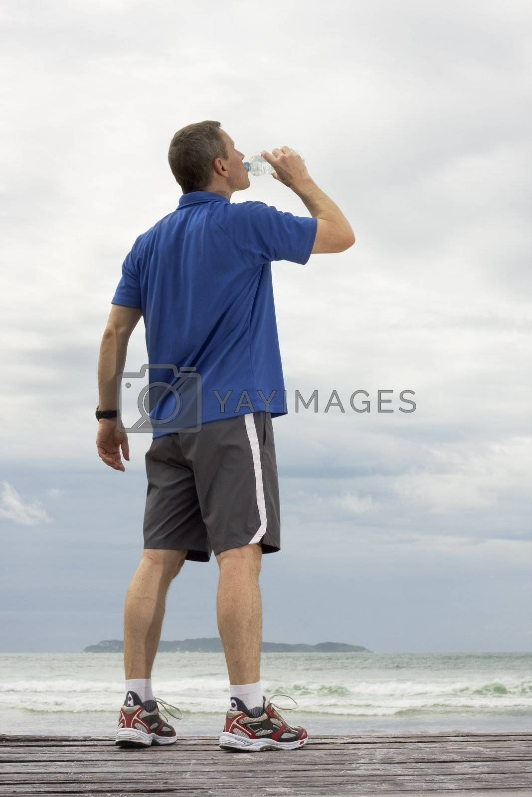 Mature runner drinking water by ArtmannWitte