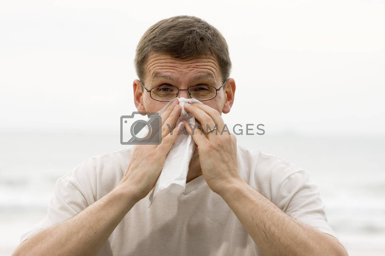 Royalty free image of Sneezing man  by ArtmannWitte