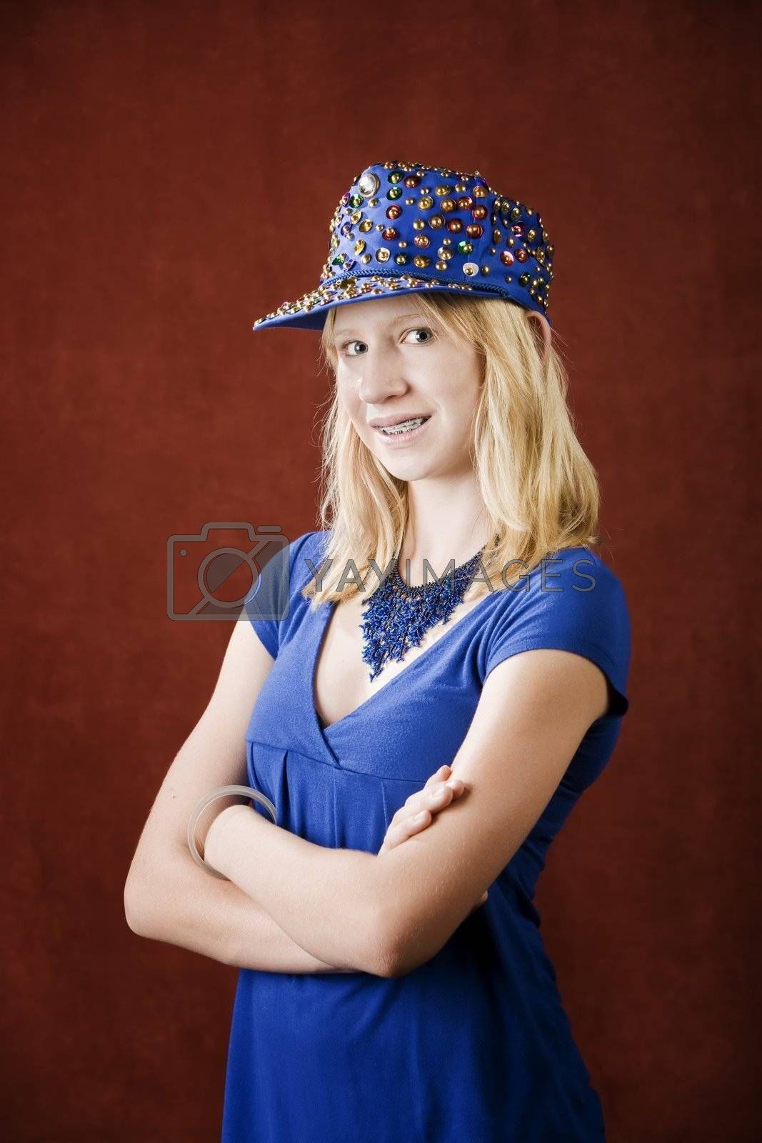 Teenage girl with braces wearing a hat with sequins