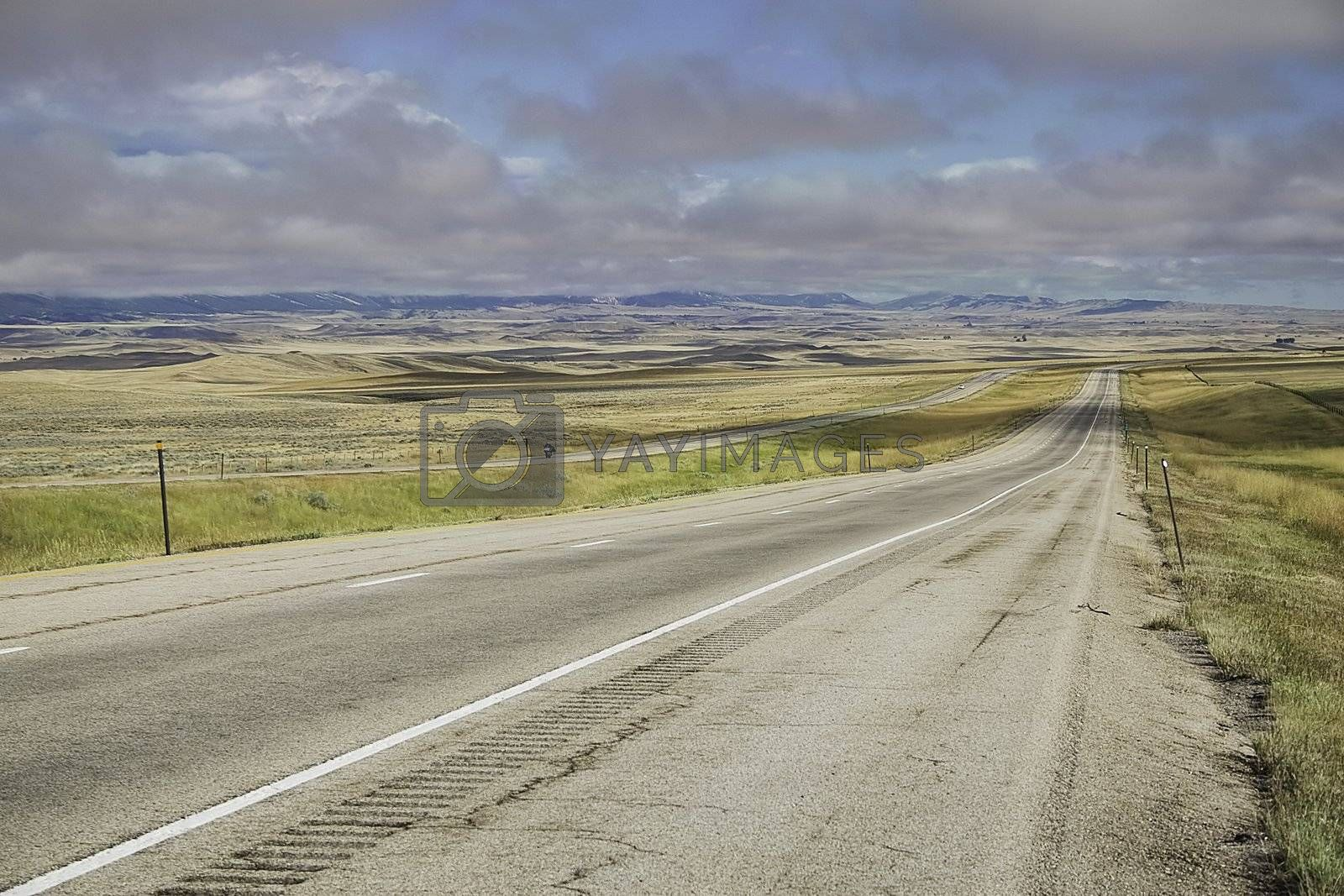 The interstate through Montana with a low cloud ceiling on a summer day.