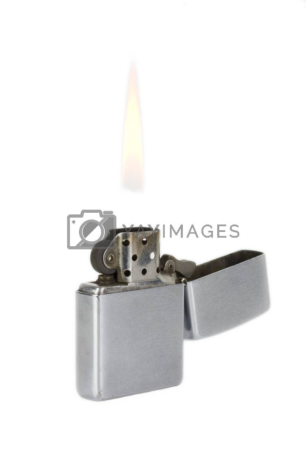 battered lighter with flame on white background