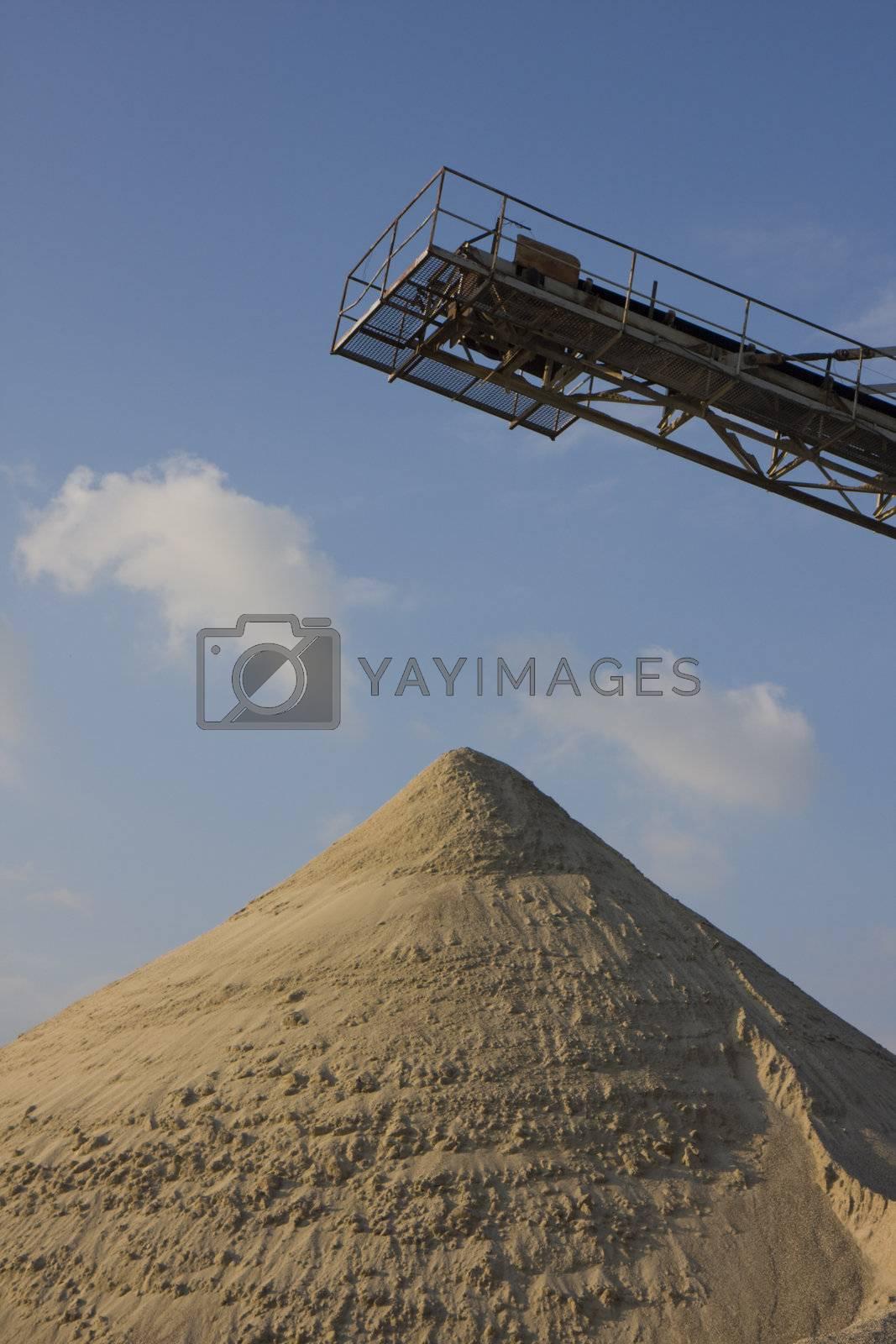 belt conveyor and a heap of gravel