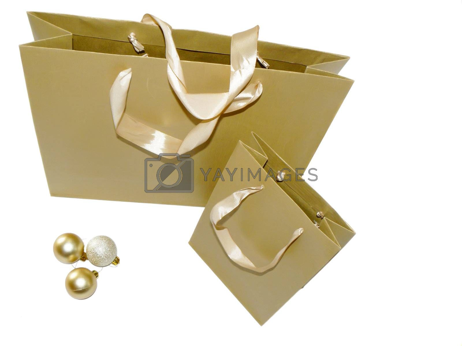 Shopping bags and xmas toys isolated on white
