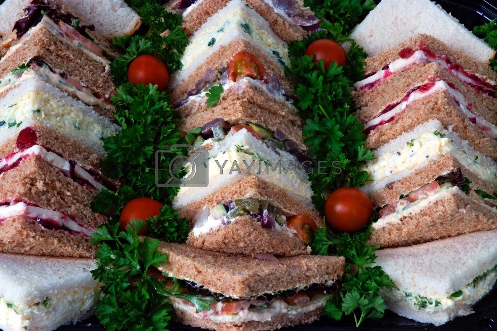 Sandwiches cut into triangles on a tray prepared for a business lunch