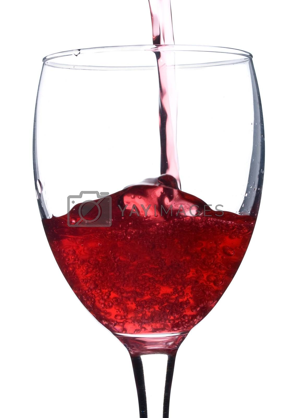 pouring red wine in glass with bubbles, isolated on white