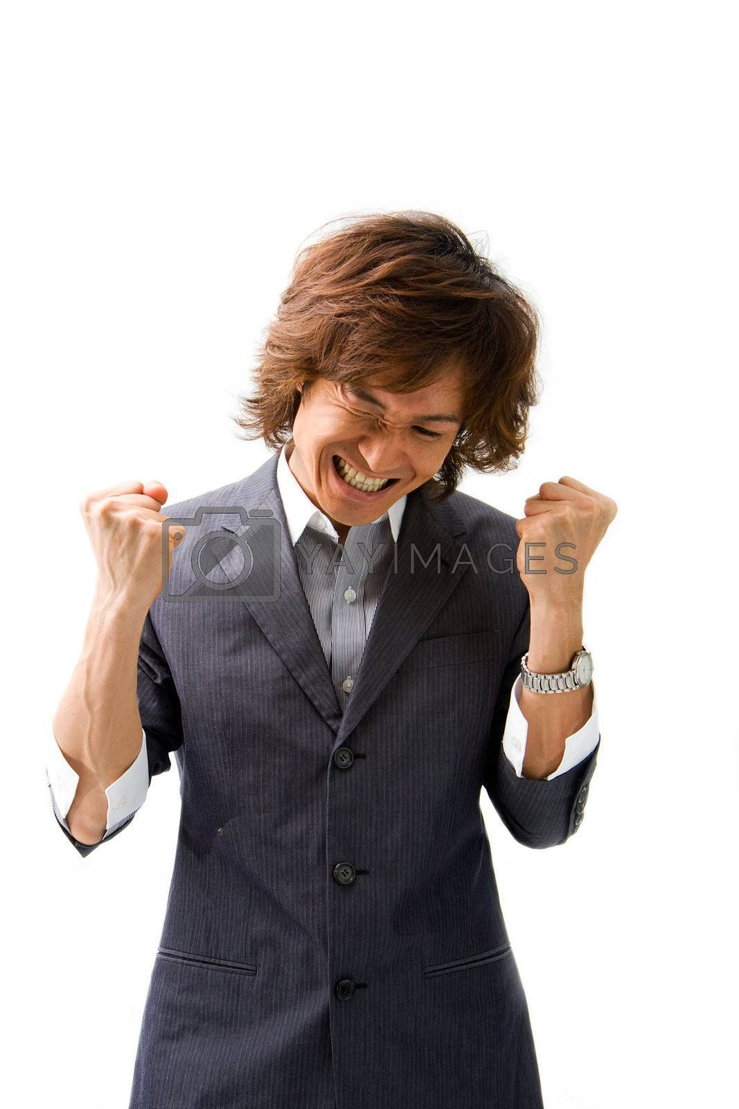 Young Asian business man celebrating a good deal, isolated