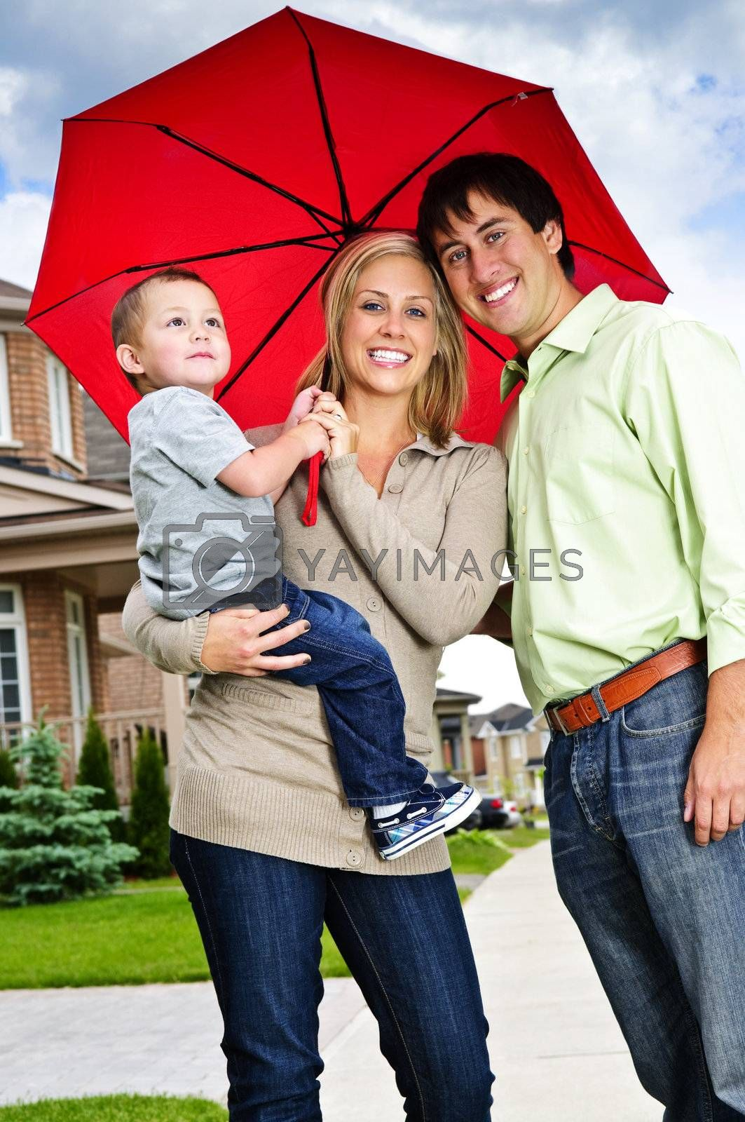 Happy family with umbrella by elenathewise