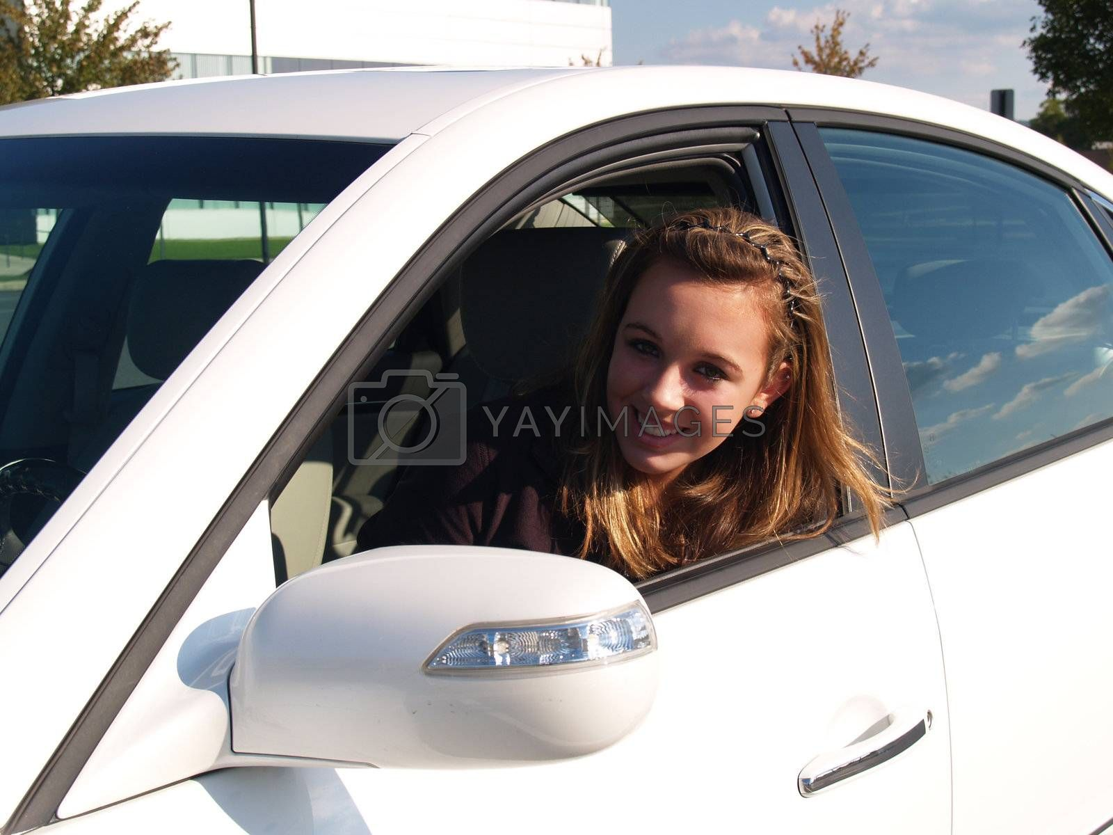 young teenage girl learning to drive