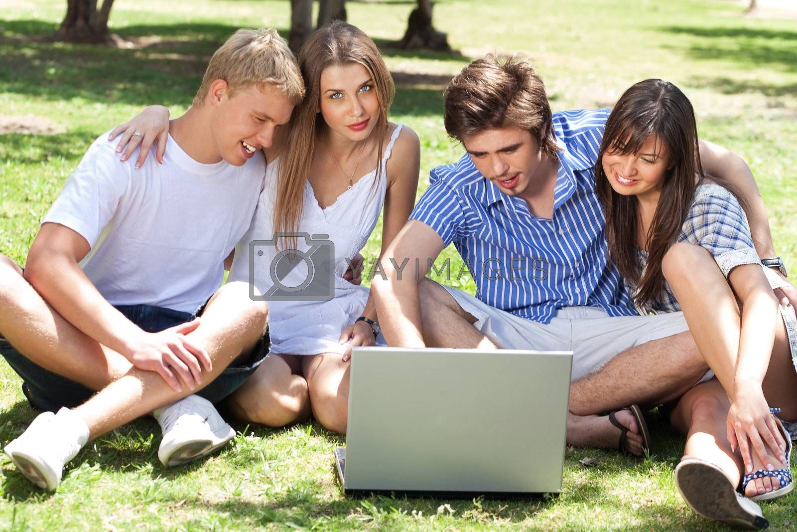 Young boys and girl students using laptop in the campus