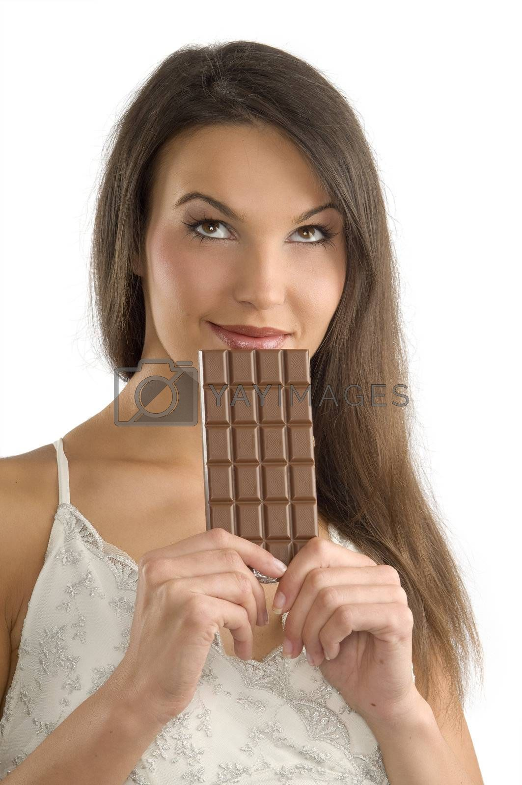 pretty brunette thinking about to eat or not  a block of chocolate