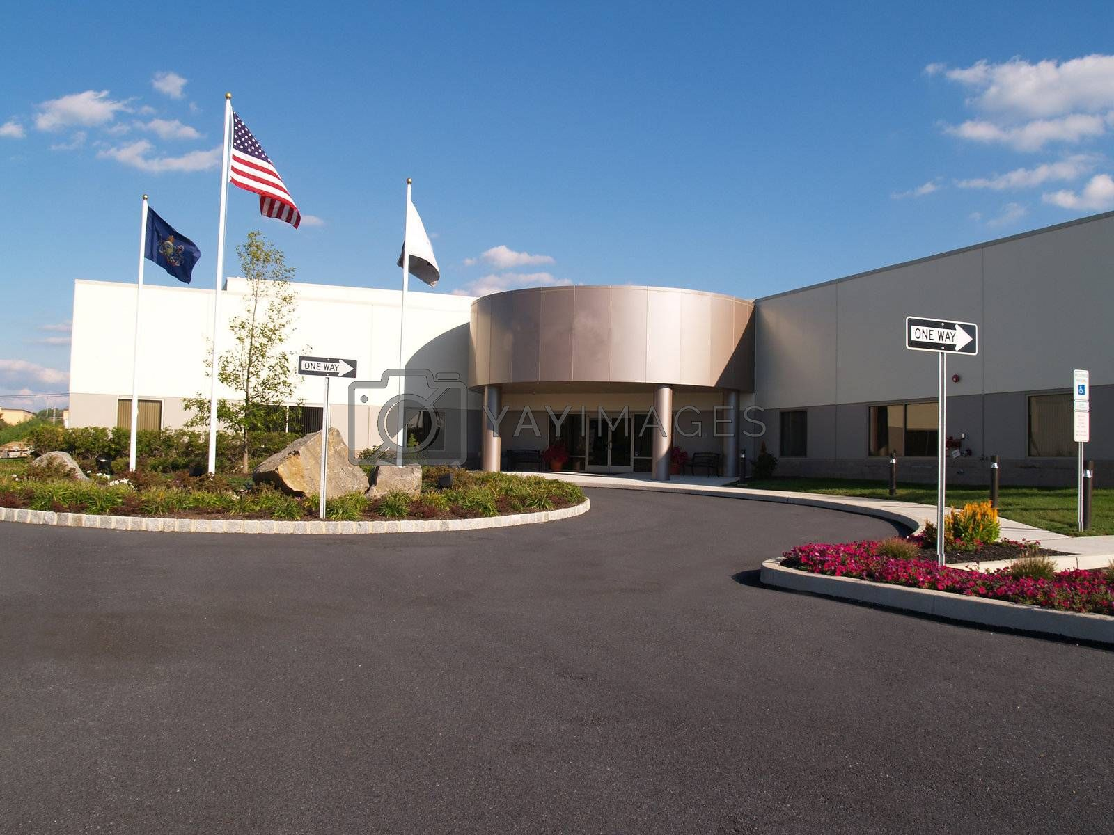 exterior of a modern industrial building with american flag