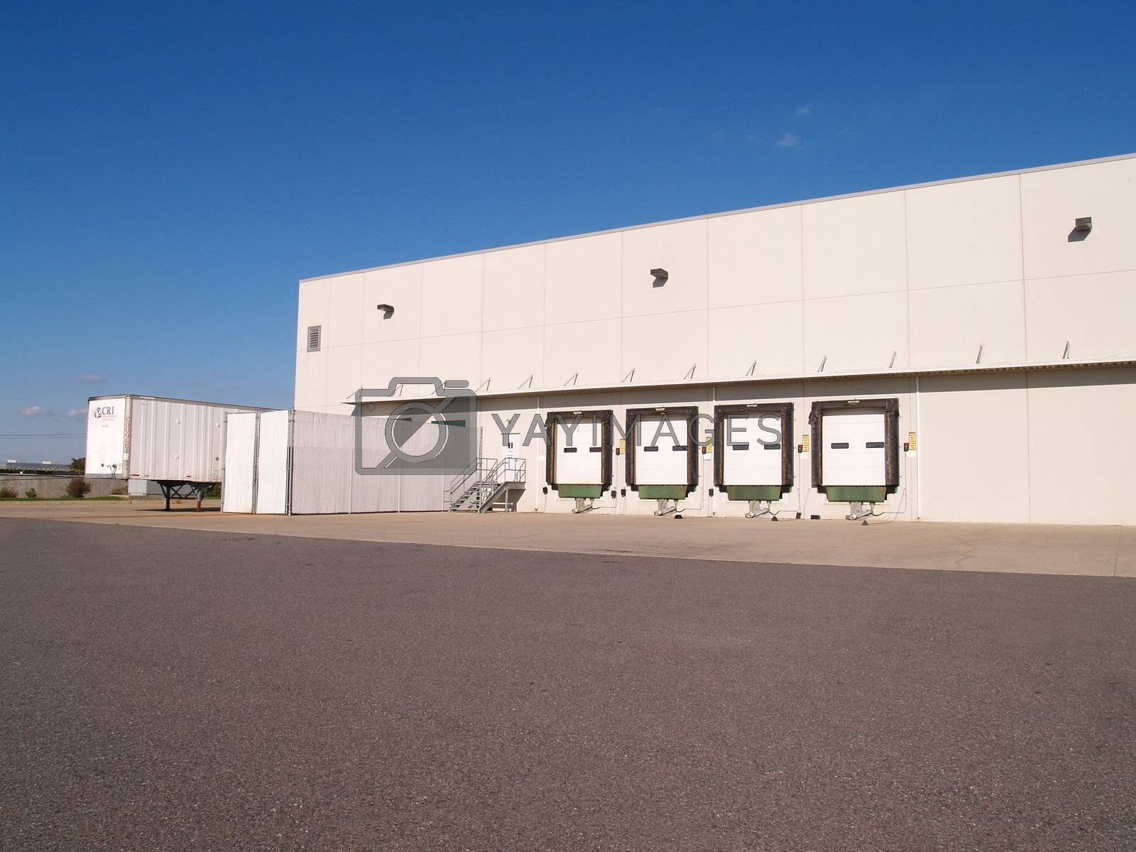 four unloading docks for an industrial warehouse