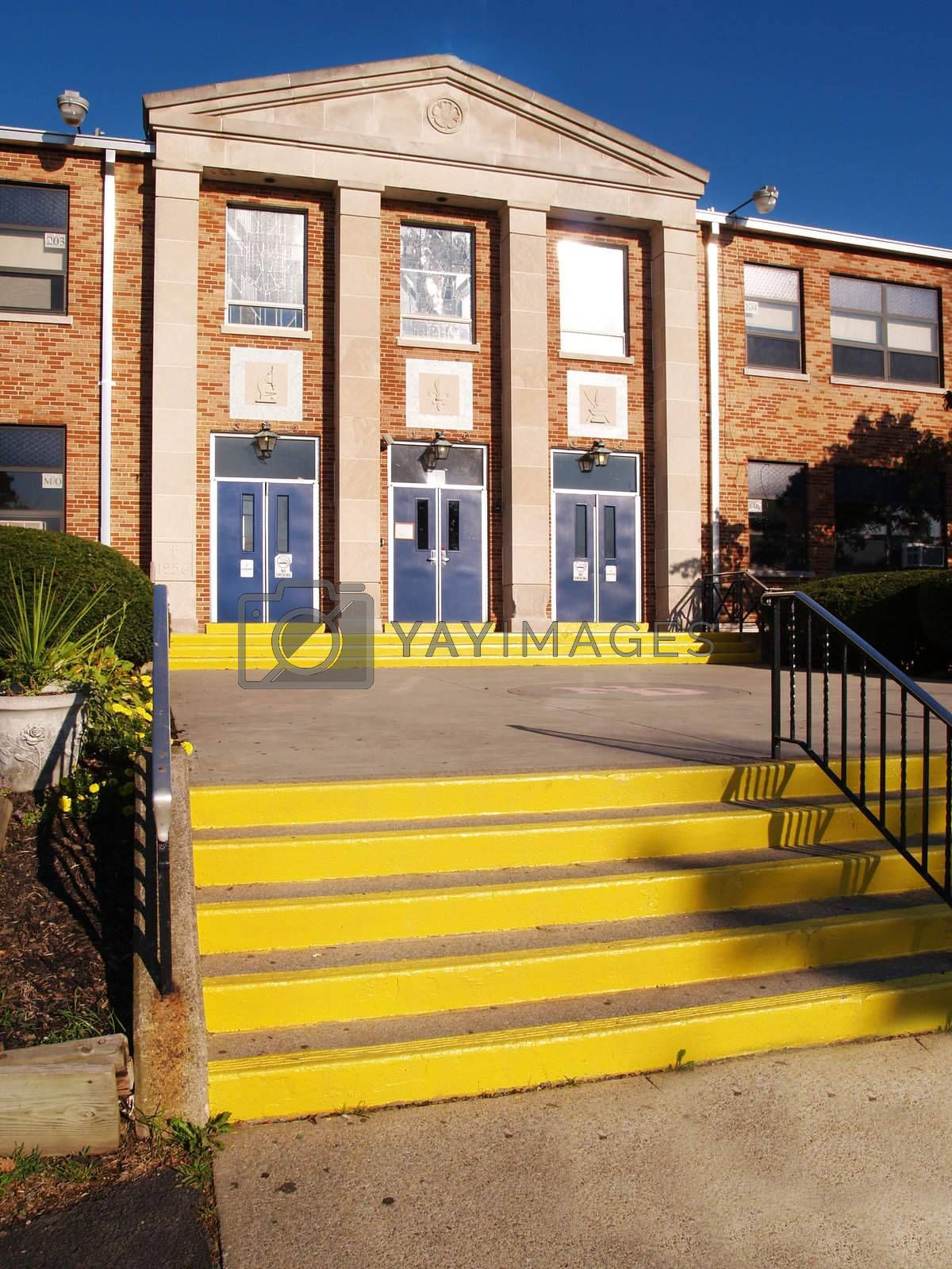 front entrance and steps for an old catholic high school