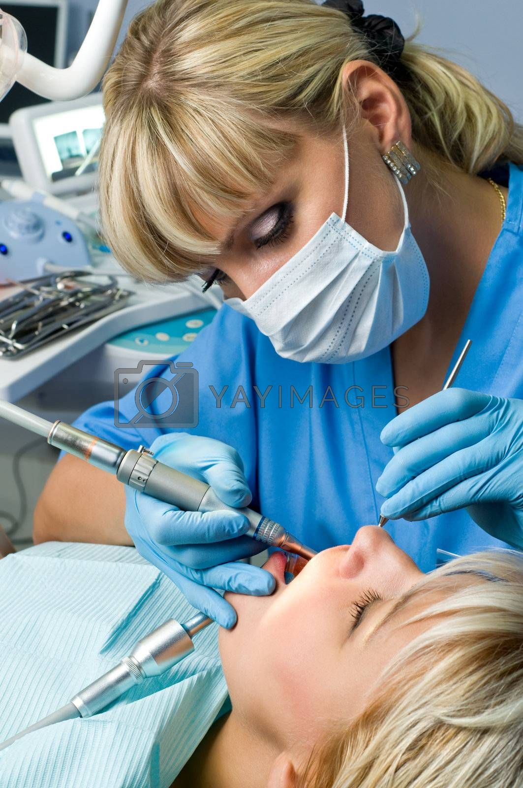 dentistry, doctor and patient, drilling the tooth