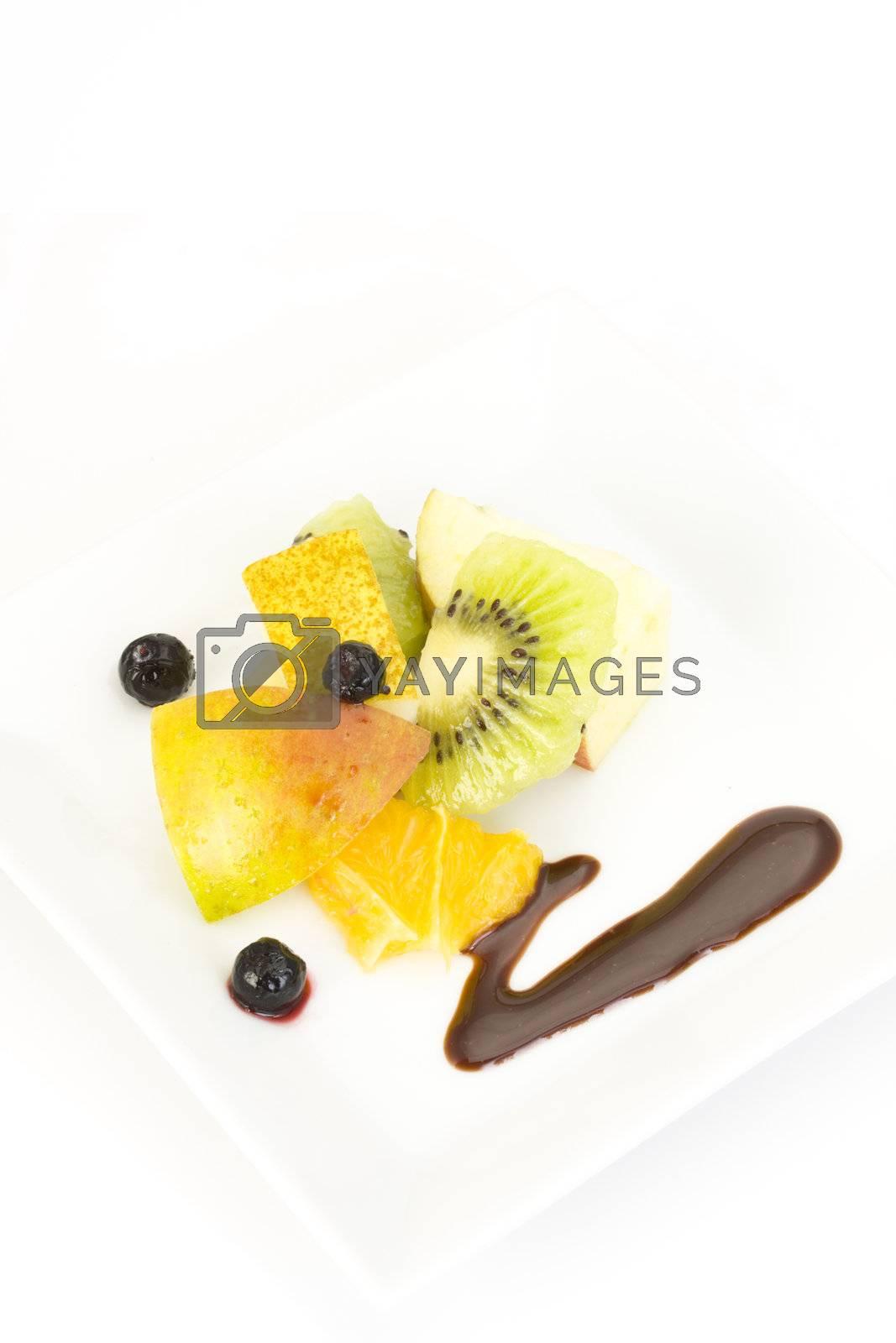 fruit salad composed of kiwi, orange, apple, lime and lemon slices